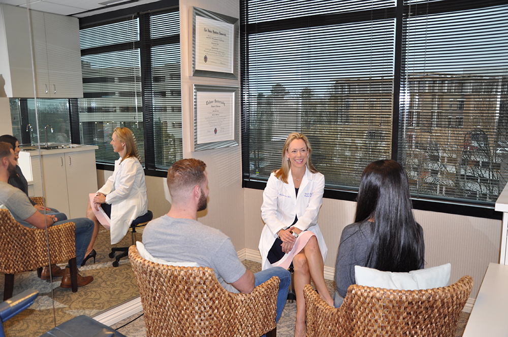 Dr. Amy Alderman consulting with a couple in her Atlanta office